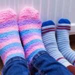 Warming feet by the radiator